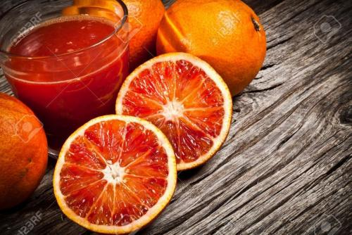 11092857-fresh-Sicilian-orange-juice-tarot-on-wood-Stock-Photo.jpg